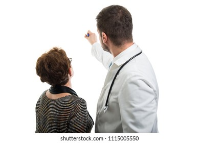 Back view of male doctor pointing to female senior patient with blue marker isolated on white background