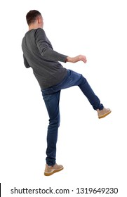Back view man Balances waving his arms. Rear view people collection. backside view of person.  Isolated over white background. Man kicks forward.