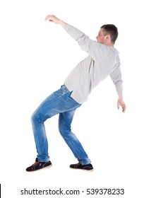 Back view man Balances waving his arms. Rear view people collection. backside view of person.  Isolated over white background. slipping man
