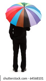 Back view of a man with big, colorful umbrella