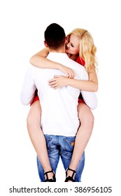 Back view of man carrying his girlfriend