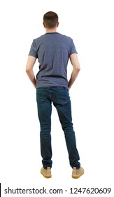 Back view of man in dark jeans. Standing young guy. Rear view people collection.  backside view of person. Isolated over white background. guy in summer clothes is standing with his back in his jeans