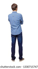 Back view of man in dark jeans. Standing young guy. Rear view people collection.  backside view of person.  Isolated over white background. A young guy in a plaid shirt stands with his arms crossed.
