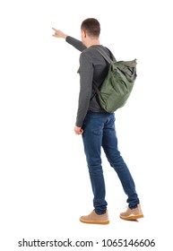 Back view of a man with a green backpack pointing forward.  backside view of person.  Rear view people collection. Isolated over white background.