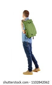 Back view of a man with a green bag.  backside view of person.  Rear view people collection. Isolated over white background. A student with a bag thrown over his shoulder looks thoughtfully