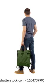 Back view of a man with a green bag.  backside view of person.  Rear view people collection. Isolated over white background. Stylish brunette holds a knapsack handle