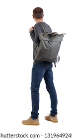 Back view of a man with a green bag.  backside view of person.  Rear view people collection. Isolated over white background. A man with a big green backpack on his shoulder is looking forward.