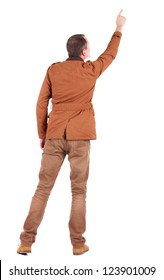 Back view of  man in jacket  pointing. Young handsome guy in jeans and  jacket showing. Rear view people collection.  backside view of person.  Isolated over white background.