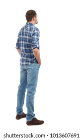 Back view of man in jeans. Standing young guy. Rear view people collection.  backside view of person.  Isolated over white background. A man in a blue shirt stands by putting his hands in his pockets