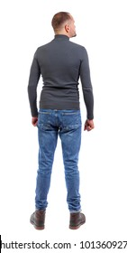 Back view of man in jeans. Standing young guy. Rear view people collection.  backside view of person.  Isolated over white background. a shortly cropped man in a dark sweater is interested in looki