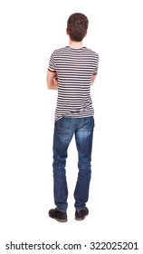 Back view of man in jeans. Standing young guy. Rear view people collection.  backside view of person.  Isolated over white background. The guy in the striped shirt with her arms folded standing.