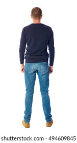 Back view of man in jeans. Standing young guy. Rear view people collection.  backside view of person.  Isolated over white background.  A guy in a black sweater standing with her hands down.