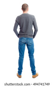 Back view of man in jeans. Standing young guy. Rear view people collection.  backside view of person.  Isolated over white background.  A guy in a gray sweater standing with folded hands in his