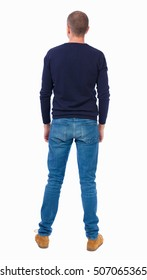 Back view of man in jeans. Standing young guy. Rear view people collection.  backside view of person.  Isolated over white background.  Man in warm jacket standing and looking.