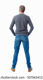 Back view of man in jeans. Standing young guy. Rear view people collection.  backside view of person.  Isolated over white background.  guy in a gray sweater standing with folded hands in his pockets