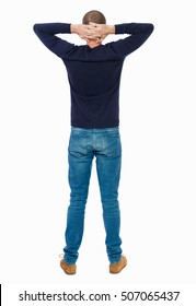 Back view of man in jeans. Standing young guy. Rear view people collection.  backside view of person.  Isolated over white background.  Man in warm jacket standing with hands clasped at the back.