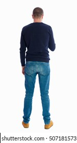 Back view of man in jeans. Standing young guy. Rear view people collection.  backside view of person.  Isolated over white background.  A guy in a black sweater standing and looking at the phone.