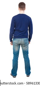 Back view of man in jeans. Standing young guy. Rear view people collection.  backside view of person.  Isolated over white background. Man in jeans and a blue sweater standing and looking.
