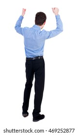 Back view of  man.  Raised his fist up in victory sign.   Rear view people collection.  backside view of person.  Isolated over white background. Businessman in blue shirt happily raised his hands.