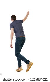 Back view of a man running and pointing his hand. walking young guy . Rear view people collection.  backside view of person.  Isolated over white background. The guy in a panic runs away
