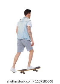Back view of a man with a skateboard. Rear view people collection.  backside view of person.  Isolated over white background. Skateboarder in shorts rides