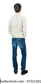 Back view of man . Standing young guy. Rear view people collection.  backside view of person.  Isolated over white background.Curly short-haired man in a woolen white jacket standing with his hands in