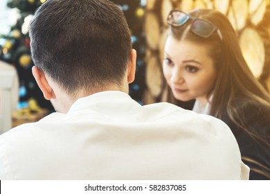 Back view of man talking with woman