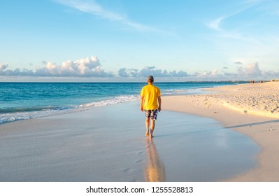 Back View of a Man Walking on a Caribbean Beach