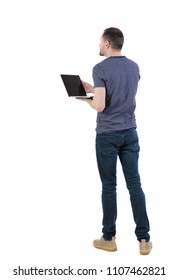 Back view of a man who is standing with a laptop. Rear view people collection.  backside view of person.  Isolated over white background. Student with laptop shows presentation