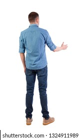 Back view of a man who stretches his hand for a handshake. Rear view  people collection.  backside view of person.  Isolated over white background. guy in the shirt holds out his hand for a greeting.