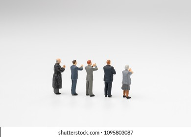 Back view of miniature people happy team member, colleague or audiences clapping appreciating after success in work, reach goal or target or meeting on white background.