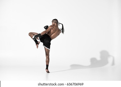 back view of muay thai fighter training isolated on white, fight club concept