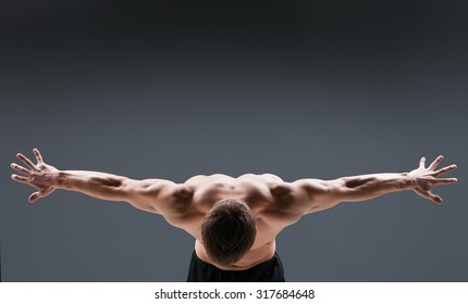 Back view of muscular young man  shows the different movements and body parts