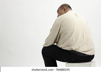 back view obesity businessman sittnig on box