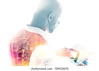 Back view of an office worker pointing finger on a tablet pc double exposure