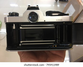 The back view of an old camera on film with the curtain broken and waste