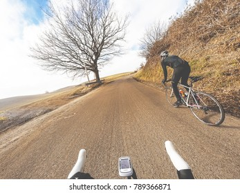 Back view of Pair of cyclist on road bike in winter season. Original point of view