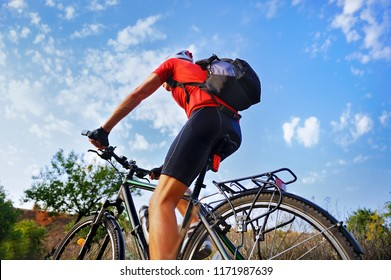 Back view picture of a cyclist riding outdoor