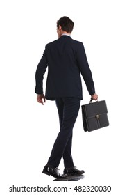 back view picture of a young business man walking while holding briefcase and looks to side on white background