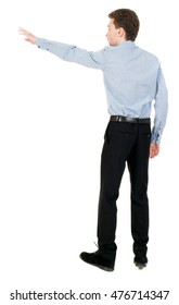 Back view of pointing business man. Isolated over white background. Businessman in a shirt and a bow tie is back and shows his hand.