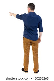 Back view of pointing business man. man in a blue shirt with the sleeves rolled up showing the right hand side.