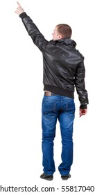 Back view of pointing  man in jeans and jacket. Rear view people collection.  backside view of person.  Isolated over white background.  gesticulating young guy.
