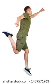 Back view of pointing man in zero gravity or a fall. guy is flying, falling or floating in the air.  Isolated over white background. The guy in shorts and sneakers in a jump is trying to reach