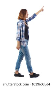 back view of pointing walking  woman. going girl pointing.  backside view of person.  Rear view people collection. Isolated over white background. A girl wearing a blue checkered shirt shows her hand