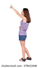 Back view of  pointing woman. beautiful brunette  girl.  Rear view people collection.  backside view of person.  Isolated over white background.