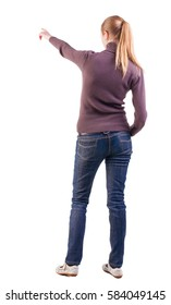 Back view of  pointing woman. beautiful blonde  girl in jeans. girl in a sweater and sandals considering something far. Rear view people collection.  backside view of person.