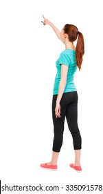 Back view of  pointing woman in sportswear. beautiful girl. Rear view people collection.  backside view of person.  Isolated over white background.