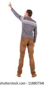Back view of  pointing young men in  sweater and jeans. Young guy  gesture. Rear view people collection.  backside view of person.  Isolated over white background.