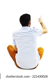 Back view of pointing young men sitting on floor. Young guy gesture. Rear view people collection. backside view of person. Isolated over white background.