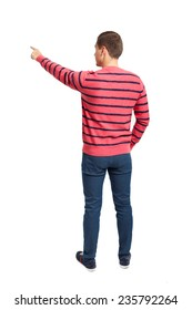 Back view of pointing young men in shirt and jeans. Rear view people collection. Backside view of person. Isolated over white background.